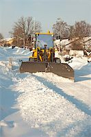 snow plow truck - A tractor shoveling snow in a suburban street Stock Photo - Royalty-Freenull, Code: 400-05270016