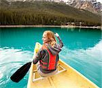 A happy woman in a canoe on a clear glacial lake Stock Photo - Royalty-Free, Artist: Leaf, Code: 400-05270921