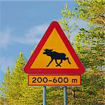 yellow moose warning traffic sign in Sweden Stock Photo - Royalty-Free, Artist: Kartouchken                   , Code: 400-05272527
