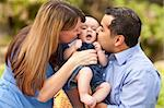Happy Mixed Race Parents Playing with Their Giggling Son. Stock Photo - Royalty-Free, Artist: Feverpitched                  , Code: 400-05276428
