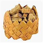 Home-made brown rusks in small birch-bark box over white background Stock Photo - Royalty-Free, Artist: DLameko                       , Code: 400-05278293