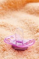 photo shot of the pacifier on soft background Stock Photo - Royalty-Freenull, Code: 400-05278332