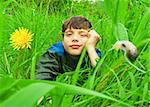 The white boy lies on a meadow against dandelions and a snail Stock Photo - Royalty-Free, Artist: papa1266                      , Code: 400-05279314