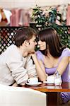 Loving couple talks behind a little table in cafe Stock Photo - Royalty-Free, Artist: Deklofenak                    , Code: 400-05279618