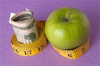 education loan - An apple, tape measure, and American currency represents the concept of measuring the cost of healthcare, food, or education.  Can also work for concept of the cost of healthcare, education or food. Stock Photo - Royalty-Freenull, Code: 400-05280675