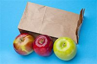 Healthy School Lunch Themed Image with Apples and a Brown Bag. Stock Photo - Royalty-Freenull, Code: 400-05281066
