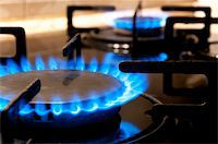 stove - Black gas stove and two burning flames close-up   Stock Photo - Royalty-Freenull, Code: 400-05284092