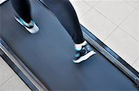Girl's feet close-up when running on a treadmill Stock Photo - Royalty-Freenull, Code: 400-05286630