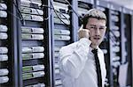 young business man computer science engeneer talking by cellphone at network datacenter server room asking  for help and fast solutions and services Stock Photo - Royalty-Free, Artist: dotshock                      , Code: 400-05291408