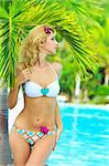 Beautiful woman near swimming pool under palm tree Stock Photo - Royalty-Free, Artist: GoodOlga                      , Code: 400-05293620