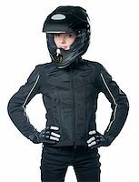Young beauty woman in black motorcycle clothing and helmet posing. Isolated on white. Stock Photo - Royalty-Freenull, Code: 400-05294511