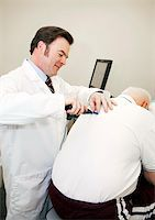 Chiropractor uses a computerized tool to adjust a patient's back. Stock Photo - Royalty-Freenull, Code: 400-05298108