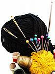 different knitting items over the white background Stock Photo - Royalty-Free, Artist: SNR                           , Code: 400-05299683