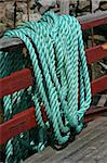 Green ship rope hanging on a fence Stock Photo - Royalty-Free, Artist: Kartouchken                   , Code: 400-05305644
