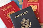 multiple passports with background of map Stock Photo - Royalty-Free, Artist: gksd777                       , Code: 400-05305834
