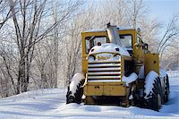 snow plow truck - Snow covered tractor abandoned Stock Photo - Royalty-Freenull, Code: 400-05306872