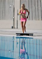 sweaty woman - young beautiful healthy woman exercise fitness and stepping at swimming pool Stock Photo - Royalty-Freenull, Code: 400-05307090