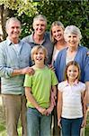 Family looking at the camera in the garden Stock Photo - Royalty-Free, Artist: 4774344sean                   , Code: 400-05314320