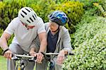 Mature couple mountain biking outside Stock Photo - Royalty-Free, Artist: 4774344sean                   , Code: 400-05314402