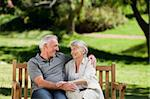 Senior couple sitting on a bench Stock Photo - Royalty-Free, Artist: 4774344sean                   , Code: 400-05314986