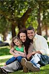 Radiant family sitting in the garden Stock Photo - Royalty-Free, Artist: 4774344sean                   , Code: 400-05315204