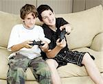 Two brothers at home playing video games together. Stock Photo - Royalty-Free, Artist: lisafx                        , Code: 400-05315408