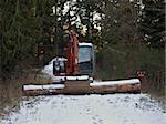 Front end loader and large log enforcing the No Trespassing sign. Stock Photo - Royalty-Free, Artist: naturediver                   , Code: 400-05315459