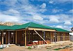 New residential construction home framing against a blue sky. Stock Photo - Royalty-Free, Artist: LevKr                         , Code: 400-05323601