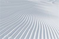 tracks on ski slopes in snow at beautiful sunny  winter day with blue sky Stock Photo - Royalty-Freenull, Code: 400-05328789