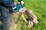 Man cutting the log of wood with chainsaw Stock Photo - Royalty-Free, Artist: Dan70                         , Code: 400-05329658