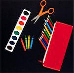 Art supplies for students starting school: colored pencils, paints, crayons, scissors on black background Stock Photo - Royalty-Free, Artist: waxart                        , Code: 400-05340915