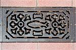 Decorated sewer grate in a street of Vila Real de Santo Antonio, Algarve, Portugal Stock Photo - Royalty-Free, Artist: mrfotos                       , Code: 400-05344766