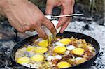 Fried eggs. Cooking on the fire. Stock Photo - Royalty-Free, Artist: BSANI                         , Code: 400-05346391