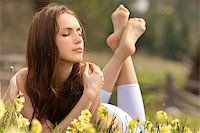 Young woman lying on field dreaming summer day Stock Photo - Royalty-Freenull, Code: 400-05346926