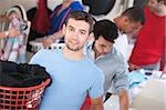 Handsome young blue-eyed Caucasian man in a laundromat Stock Photo - Royalty-Free, Artist: creatista                     , Code: 400-05347597