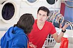 Two young men argue in the laundromat Stock Photo - Royalty-Free, Artist: creatista                     , Code: 400-05347605