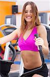 Young fit woman doing cardio exercise and posing in front of camera.. Stock Photo - Royalty-Free, Artist: get4net                       , Code: 400-05355928