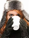 young woman in winter dress drinking coffee or tea from a cup on white background Stock Photo - Royalty-Free, Artist: RobStark                      , Code: 400-05360196