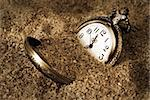 A pocket watch is buried in the dirty sand. Stock Photo - Royalty-Free, Artist: AlphaBaby                     , Code: 400-05361553