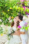 Bride and groom in a tropical garden Stock Photo - Royalty-Free, Artist: GoodOlga                      , Code: 400-05363802