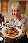 Woman With Hors D'oeuvres For A Dinner Party Stock Photo - Royalty-Free, Artist: MonkeyBusinessImages          , Code: 400-05364197
