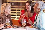 Friends Having Dinner Together At A Restaurant Stock Photo - Royalty-Free, Artist: MonkeyBusinessImages          , Code: 400-05364263
