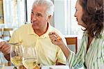 Friends Having Lunch Together At A Restaurant Stock Photo - Royalty-Free, Artist: MonkeyBusinessImages          , Code: 400-05364277