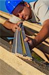 Builder carpenter measuring wood planck looking closely - shallow depth, focus on foreground Stock Photo - Royalty-Free, Artist: lightkeeper                   , Code: 400-05370276