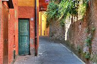 Narrow street among colorful houses and stone wall in Portofino, Italy. Stock Photo - Royalty-Free, Artist: rglinsky, Code: 400-05370575