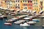 View on boats floating along multicolored houses of Portofino - small town on Ligurian sea in northern Italy. Stock Photo - Royalty-Free, Artist: rglinsky                      , Code: 400-05370578