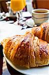 Breakfast with coffee and croissants in a basket on table Stock Photo - Royalty-Free, Artist: ilolab                        , Code: 400-05371270
