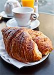 Breakfast with coffee and croissants in a basket on table Stock Photo - Royalty-Free, Artist: ilolab                        , Code: 400-05371295
