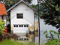 flooded homes - house surrounded by water in river during spring flood in Serbia Stock Photo - Royalty-Freenull, Code: 400-05371382
