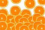 a pile of orange slices on a white background Stock Photo - Royalty-Free, Artist: nito                          , Code: 400-05372899